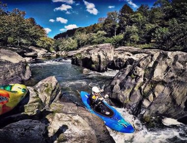 Kayaker traversing rapids
