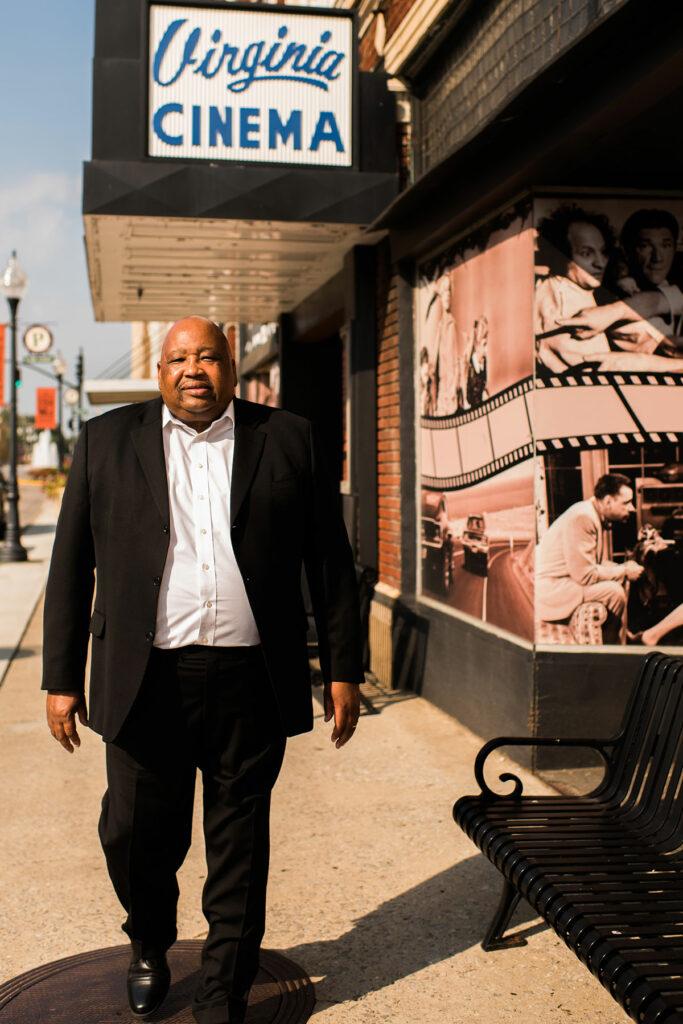 African American man walking down downtown sidewalk
